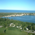 This is an aerial photo of our property that shows our proximity to The Sand Dunes Provincial Park